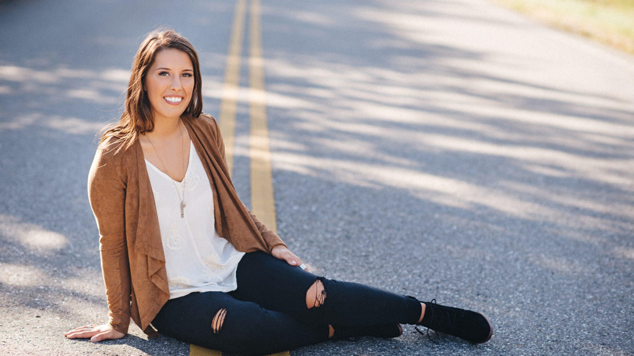 senior brunette girl leather jacket in fall senior pictures